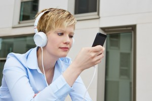 Woman using smartphone to listen to music