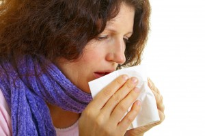Young woman with flu virus