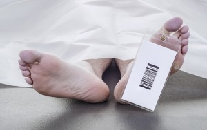 deceased man with a bar code on his toe tag,