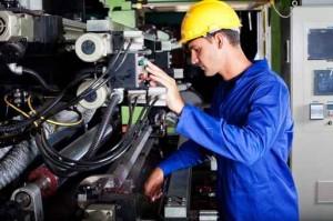 operator operating industrial printing press